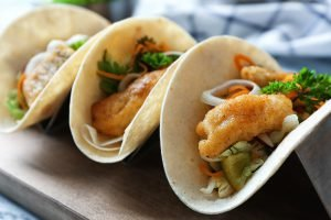 delicious fish tacos on table